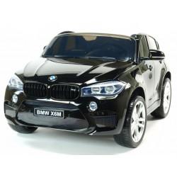 BMW X6M 2miestne,s 2,4G DO,el.brzdou,USB,MP3,voltmetrom,EVAkolesami,otv.dverami,čalunenou sedačkou,lakované čiernou farbou